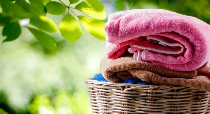 folded-linens-in-basket-min
